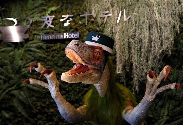 Computerstyret dinosaurus er receptionist